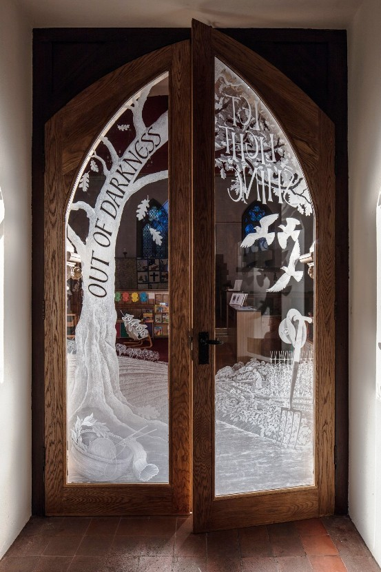 A pair of doors for All Saints, Croxley Green engraved to mark the sacrifices, hardships and bravery of those left at home during the first world war.______Image by Nick Carter